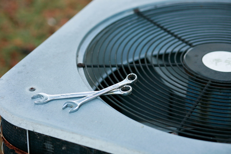 ac-unit-with-wrenches-on-it