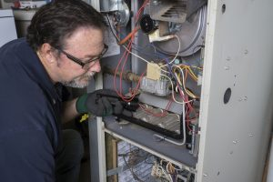 technician-looking-at-furnace